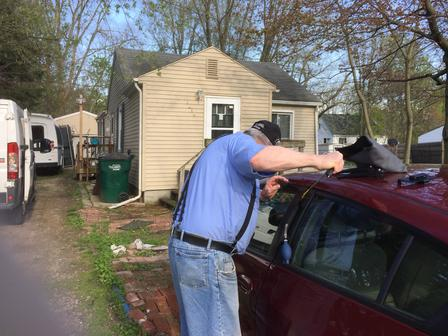 Locksmith Unlocking a Car